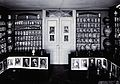 A room with shelved walls filled with decorated pharmacy jar Wellcome V0029789.jpg