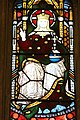 A stained glass window Jesus dressed as a King on a throne in St Andrews Church, Exwick, Exeter.jpg