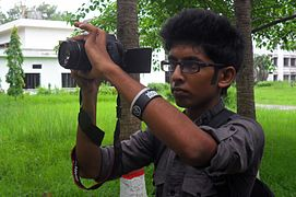 Abdullah Aarif taking photo on Wikipedia Photowalk at University of Chittagong (01).jpg