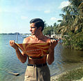 """Actor George Hamilton posing with the """"Reflect-A-Tan"""" in Palm Beach (19995867519).jpg"""