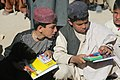 Afghan students look at supplies given to them at a school in the Shah Wali Kot district, Kandahar province, Afghanistan, Feb. 16, 2014 140216-A-YF193-089.jpg