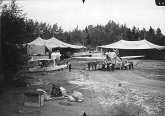 Heinkel HE 2 - 2 Swedish navy HE 2s alongside canvas hangars