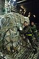 Airmen push a pallet of cargo into a C-17 Globemaster III.jpg