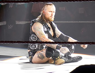 Aleister Black - Black performing his in-ring pose in May 2017