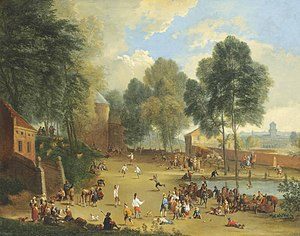 Alexander van Bredael - A village landscape with figures playing ball games