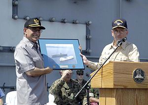 Alwi Shihab - Alwi Shihab (left) receives a commemorative photo from Rear Admiral Doug Crowder aboard USS Abraham Lincoln, February 2005