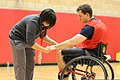 An athletic trainer with the Warrior Hope and Care Center examines U.S. Marine Corps Lance Cpl. Nicholas M. Shelton's hand, during a wheelchair basketball game at the 2012 Marine Corps Trials at Marine Corps 120216-M-IX633-211.jpg