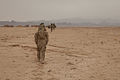 An interpreter for 4th Battalion, 25th Field Artillery Regiment, 3rd Brigade Combat Team, 10th Mountain Division, walks back to a strong-point during a dismounted patrol near Sher'Ali Kariz, Maiwand district 120226-A-QD683-068.jpg