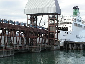 Interislander - Rail vehicles at the Wellington terminal. Both Arahura (pictured and now retired) and Aratere are capable of loading and unloading road and rail vehicles simultaneously using a double linkspan.