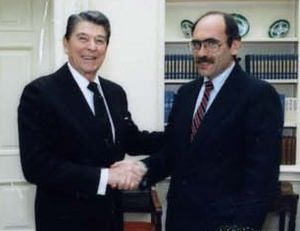 Arnold Lewis Raphel - Raphel (right) pictured with U.S. President Ronald Reagan in 1987.