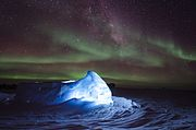 Aurora australis dancing over an LED illuminated igloo.jpg