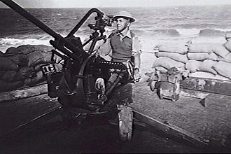 Breda Model 35 - Gunner R.K. Bryant of 8th Battery, Australian 2/3 Light Anti-Aircraft Regiment, with a Breda Model 35 gun at Derna, Libya, in March 1941. The predictor sight and a 12-round ammunition strip can be seen in this image.