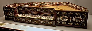 Spinet - A sumptuously decorated pentagonal spinet from 1577 by Annibale dei Rossi; 49 keys