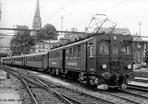 A Swiss motor coach pulling four coaches: not an EMU and not a railcar