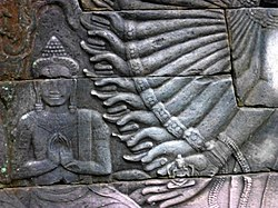 Banteay Chhmar - 067 Arms and Devotee (8593406429).jpg