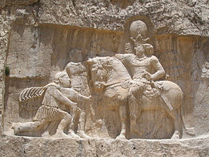 Sasanian Empire - Rock-face relief at Naqsh-e Rustam of Persian emperor Shapur I (on horseback) capturing Roman emperor Valerian (standing) and Philip the Arab (kneeling), suing for peace, following the victory at Edessa.