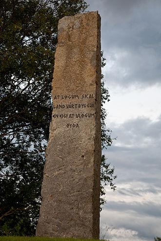 Frostating - Inscription: at lögum skal land várt byggja en eigi at ulögum øyða (with law shall our land be built, and not desolated by lawlessness)