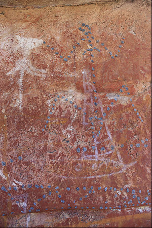 Makassan contact with Australia - A female figure outlined in beeswax over painting of a white Macassan prau