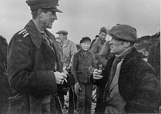 Liberation of Finnmark - Colonel A.D. Dahl (left) in conversation with Peder Holt (right), the interim Governor of Finnmark, in Vadsø, in late 1944