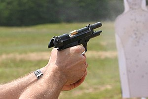 Beretta M9 - M9 during firing with cartridge casing being ejected