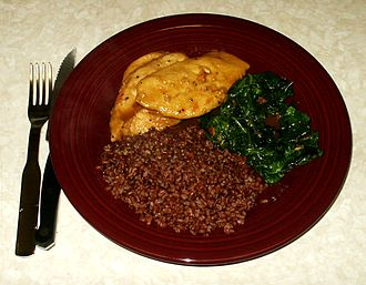 Traditional dish with lemon glazed chicken, sauteed spinach and steamed Bhutanese red rice Bhutanese red rice with chicken and spinach.jpg