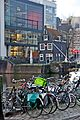 Bikes and a leaning house in Amsterdam.jpg