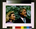 Bill Clinton and Hillary Rodham Clinton, head-and-shoulders portrait, facing right, outdoors.tif