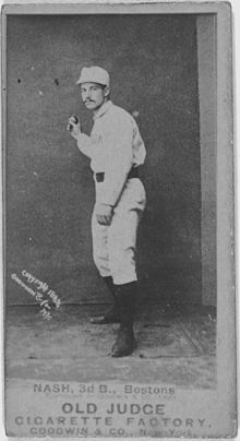 A black-and-white baseball card image of a mustachioed man wearing a white old-style baseball uniform and cap