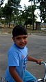 Blue clothed little cyclist boy - cycling near Nishapur railway station 02.JPG