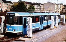 A light-blue tram