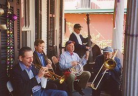 A traditionalist jazz band plays at a party in New Orleans in 2005. Shown here are Chris Clifton, on trumpet; Brian O'Connell, on clarinet; Les Muscutt, on banjo; Chuck Badie, on string bass; and Tom Ebert, on trombone.