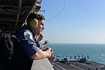 British sailors from Royal Navy frigate HMS Monmouth (F-235) observe flight operations aboard the aircraft carrier USS John C. Stennis (CVN 74) in U.S. 5th Fleet area of responsibility Jan. 15, 2013 130115-N-ZB122-123.jpg
