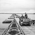 British vehicles crossing 'Lambeth Bridge', one of the pontoon bridges over the Rhine in Germany, 26 March 1945 BU2417.jpg