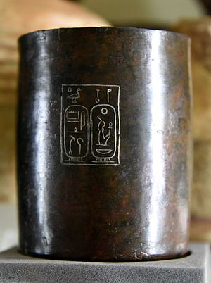 Ancient Egyptian units of measurement - A bronze capacity measure inscribed with the cartouches of the birth and throne names of Amenhotep III of the 18th Dynasty
