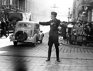 National Socialist Motor Corps - An NSKK man directs traffic in Posen, October 1939
