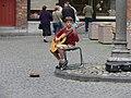 Busking boy Brugge guitar.jpg