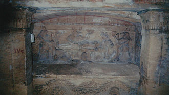 Catacombs of Kom El Shoqafa - Sarcophagus with bas relief showing Egyptian gods and priests offering sacrifices
