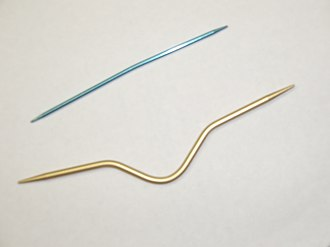 Cable knitting - Two different styles of cable needles.