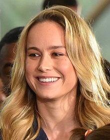 A head shot of Brie Larson as she looks away from the camera
