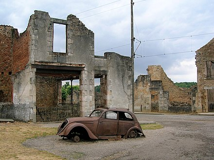 Burned out cars and buildings still litter the remains of the original village in Oradour-sur-Glane, as left by Das Reich SS division Car in Oradour-sur-Glane4.jpg