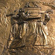Transporting the Ark of the Covenant: gilded brass-relief at the Auch Cathedral