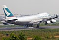 Cathay Pacific Boeing 747-467F(ER) B-HUP Smokey Landing (8225753031).jpg