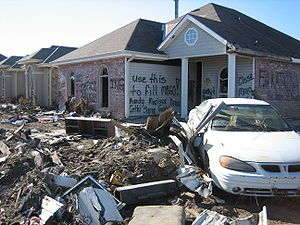 Mississippi River–Gulf Outlet Canal - Inscription on house in storm-surge devastated neighborhood of Chalmette, Louisiana suggests that the ruins be used to fill MRGO.