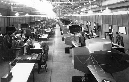 Rows of Link trainers fill this Chanute Field, Illinois, classroom in 1943. These trainers were used to teach both Link trainer operators and maintenance technicians. - Chanute Air Force Base