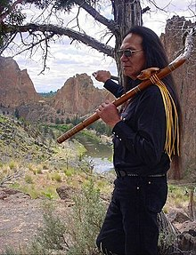 Charles Littleleaf with his Native American flute.jpg