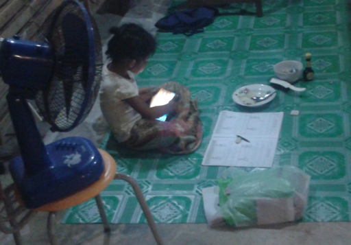 Child using a low cost tablet computer in Thailand