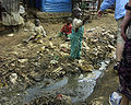 Children and open sewer in Kibera.jpg