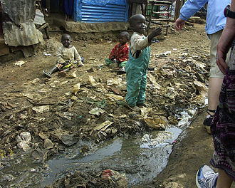 Malnutrition in children - Poor sanitary conditions in environment that can contribute to malnutrition and disease in children (Kibera, Kenya)