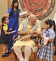 Children tying 'Rakhi' on the Prime Minister, Shri Narendra Modi's wrist, on the occasion of 'Raksha Bandhan', in New Delhi on August 29, 2015 (6).jpg