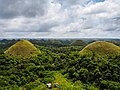 Chocolate Hills with two tourists.jpg
